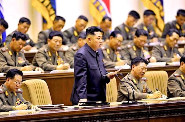 North Korean leader Kim Jong Un reportedly ordered the public executions of 80 people this month to send a message of intolerance of what the communist regime considers corruptive foreign influence. He is shown in this picture from a meeting last month with the country's military leaders. (Korea News Service / October 24, 2013)
