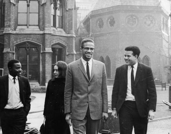 Black Nationalist leader and Nation of Islam spokesman Malcolm X in Oxford with Eric Abrahams, right, the Student Union president, before addressing university students on the subject of extremism and liberty, 3rd December 1964.  (Photo by Keystone/Hulton Archive/Getty Images)
