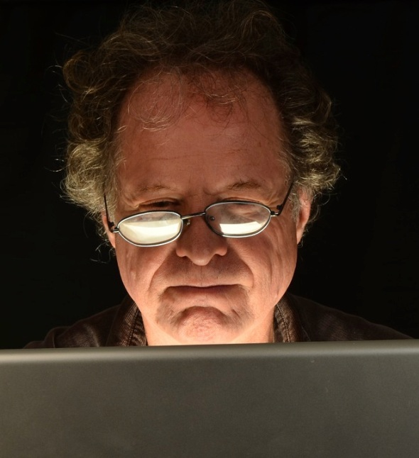 Infected computers at work are often the result of top execs watching pornography. Credit: Man using laptop image via Shutterstock