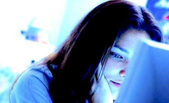 Teen Girl Using Computer --- Image by © L. Clarke/CORBIS