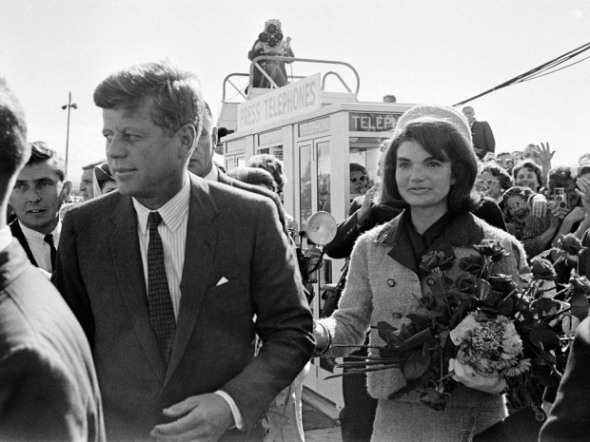 In this Nov. 22, 1963 file photo, President John F. Kennedy and his wife, Jacqueline Kennedy, arrive at Love Field airport in Dallas.
