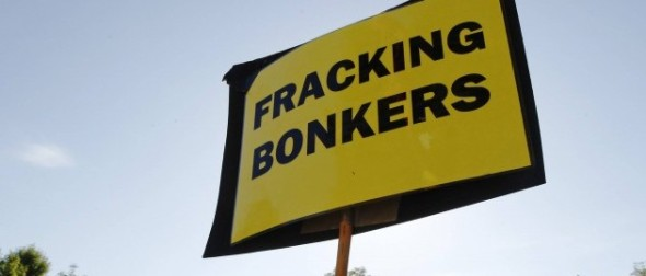 An anti-fracking sign is displayed at the protest camp by the entrance to a site run by Cuadrilla Resources, outside the village of Balcombe in southern England Aug. 6, 2013. (REUTERS/Luke MacGregor)