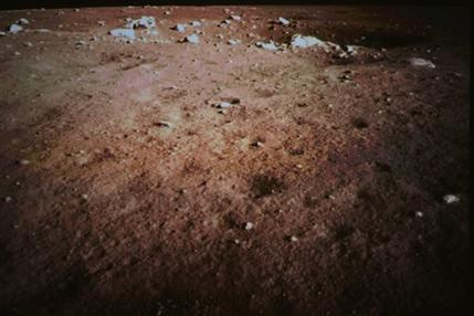 This Saturday Dec. 14, 2013 photo released by China's Xinhua News Agency, shows a picture of the moon surface taken by the on-board camera of the lunar probe Chang'e-3 on the screen of the Beijing Aerospace Control Center in Beijing, capital of China. China on Saturday successfully carried out the world's first soft landing of a space probe on the moon in nearly four decades, the next stage in an ambitious space program that aims to eventually put a Chinese astronaut on the moon. (AP Photo/Xinhua, Wang Jianmin