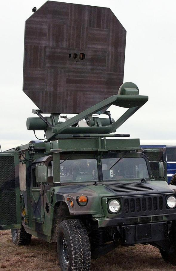 A US Marine Corps truck carries an Active Denial System. It is a nonlethal weapon that uses directed energy and projects a beam of waves up to 1000 metres. When fired at a human, it delivers a heat sensation to the skin and generally makes humans stop what they are doing and run. Source: AAP
