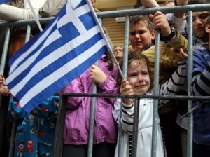 Child holding Greek Flag (photo AP)