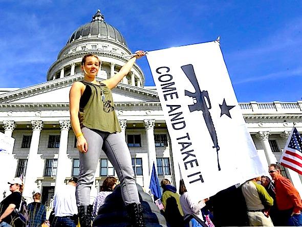 Gun rights activist Holly Cusumano, 18, waves a flag during a rally for the 2nd Amendment at the Utah State Capitol in Salt Lake City on Saturday, March 2, 2013. (AP Photo/Rick Bowmer)