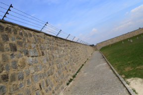 Walls with barbed wires are seen at World War II concentration camp of Mauthausen, on April 17, 2013. AFP/Getty Images