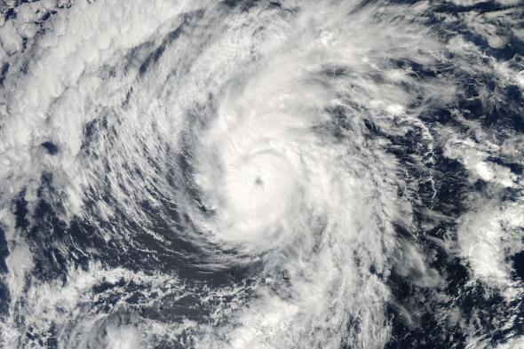 This October 27, 2013 NASA satellite image shows Hurricane Raymond churning in the Pacific Ocean off Mexico. The US National Hurricane Center says Raymond has become a hurricane far off Mexico's Pacific coast and poses no threat to land at this time. The Miami-based centre says Raymond has top sustained winds of 120 kph and is centred about 1,180 kilometres south-southwest of the southern tip of Mexico's Baja California peninsula(Top-R). Raymond as a category three hurricane brought torrential rains and flooding last week near Zihuatanejo.  AFP PHOTO/NASA