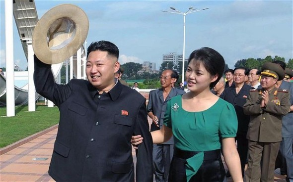 North Korean leader Kim Jong-Un (L), accompanied by his wife Ri Sol-Ju (R), visiting a wading pool at the Rungna People's Pleasure Ground in Pyongyang Photo: AFP