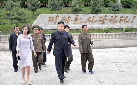 Kim Jong-Un and his wife Ri Sol-Ju visiting Pyongyang Myohyangsan Children's Camp (AFP)
