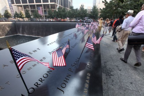 Rows of same flags are placed on the Memorial section of the South Tower at the 9/11 Memorial during ceremonies marking the 12th anniversary of the 9/11 attacks on the World Trade Center in New York, September 11, 2013 UPI/Chris Pedota /POOL