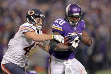 From right: Minnesota Vikings running back Adrian Peterson (28) is tackled by Chicago Bears safety Chris Conte (47) during overtime at Mall of America Field at H.H.H. Metrodome, in Minneapolis on Dec. 1, 2013.