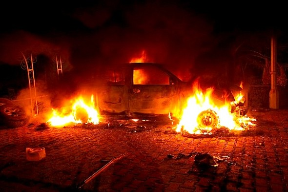 STR/AFP/Getty Images -  A vehicle and the surrounding area are engulfed in flames inside the U.S. consulate compound in Benghazi late on Sept. 11, 2012.