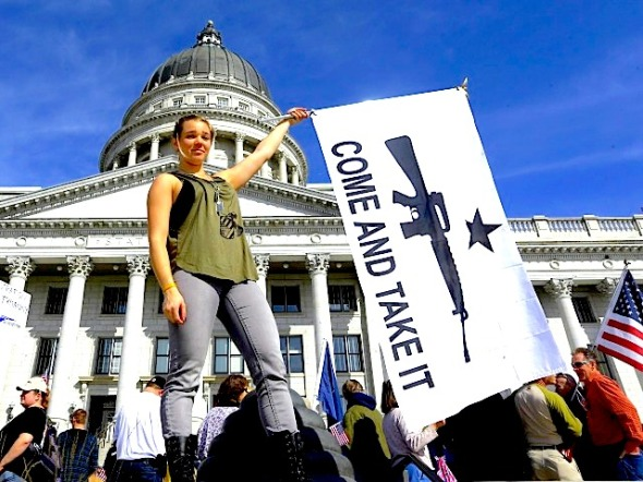 Gun rights activist Holly Cusumano, 18, waves a flag during a rally for the 2nd Amendment at the Utah State Capitol in Salt Lake City on Saturday, March 2, 2013. (AP Photo/Rick Bowmer)