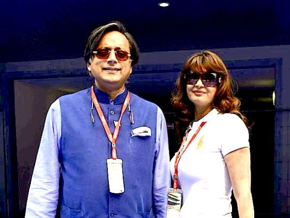 Sunanda Puskhar Tharoor, right, wife of India's Minister of State for Human Resource Development Shashi Tharoor, poses with her husband at the Indian F1 Grand Prix outside New Delhi, October 27, 2013. Sunanda, 52, was found dead in a New Delhi hotel room Friday, police said, days after she was involved in a row with a Pakistani woman on Twitter.