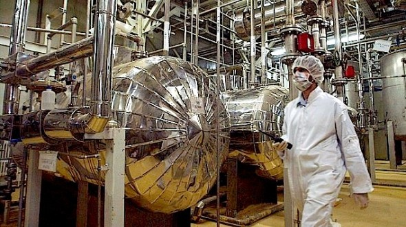 An Iranian worker at the Uranium Conversion Facility at Isfahan, 410 kilometers, south of Tehran. The conversion facility in Isfahan reprocesses uranium ore concentrate, known as yellowcake, into uranium hexaflouride gas. The gas is then taken to Natanz and fed into the centrifuges for enrichment. (photo credit: AP Photo/Vahid Salemi)