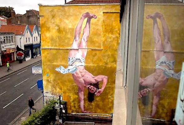 Devoutly unbelieving: on a summer's day, art enthusiasts admire Cosmo Sarson's mural of a breakdancing Christ in Stokes Croft, Bristol. Photo: Matt Cardy/Getty.