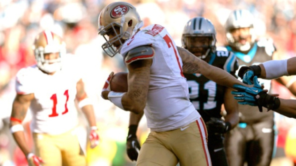Colin Kaepernick runs in a touchdown in the 3rd quarter. (Kevin C. Cox/Getty Images)