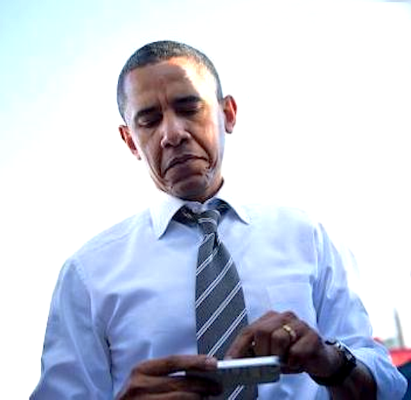 President Obama composing changes to the Affordable Care Act on his smartphone, between meetings.