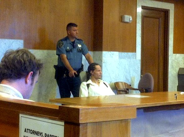 Sirgiorgio Clardy sits strapped into a restraint chair in July during his sentencing hearing. His legal adviser, sits in the foreground -- a safe distance away from Clardy based on the advice of a judge. Nine courthouse deputies attended the sentencing to maintain security. (Aimee Green/The Oregonian)