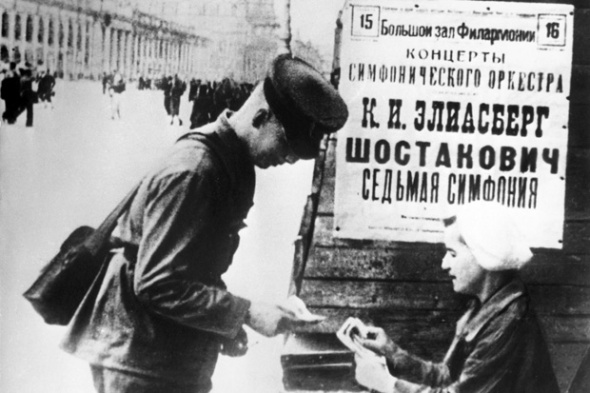 A Soviet soldier buys a ticket for the performance of the Seventh Symphony in Leningrad in August 1942