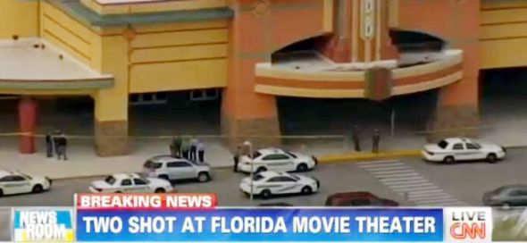 Police investegate the crime scene after two people were shot at Wesley Chapel, Florida movie theater. CNN