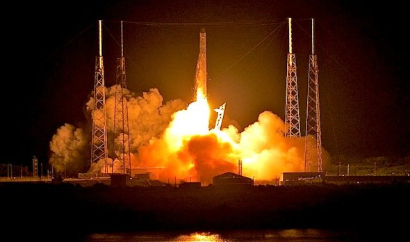 SpaceX's Dragon spacecraft atop rocket Falcon 9 lifts off from Cape Canaveral in Florida in May 2012. The launch made SpaceX the first commercial company to send a spacecraft to the International Space Station.  Roberto Gonzalez/Getty Images
