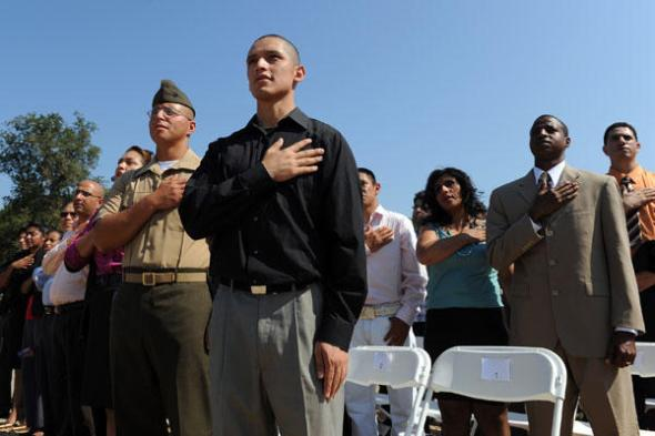 New citizens recite the Pledge of Allegiance as the US Citizenship and Immigration Services (USCIS) holds a naturalization ceremony on the steps of the Lincoln Memorial on the National Mall in Washington on Sept. 22, 2010. (UPI/Roger L. Wollenberg/Newscom)