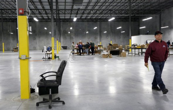Bob Grabowski (right) said his office is the first one complete at PTR Industries in the Cool Springs Business Park on Tuesday, Jan. 7, 2013. PTR Industries is a gun manufacturing company that moved from Connecticut. Grabowski is also an Horry County councilman. Photo by Janet Blackmon Morgan / jblackmon@thesunnews.com  Read more here: http://www.myrtlebeachonline.com/2014/01/09/3948593/work-begins-at-horry-countys-first.html#storylink=cpy