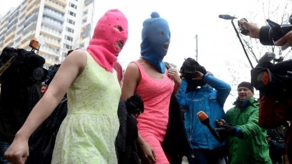 "One of the Pussy Riot band members, wearing a ski mask told reporters that Sochi was a ""political event"""