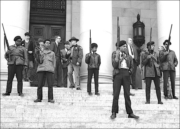 Historic photo of armed black panthers members on capitol steps in Seattle, 1969. Washington state is among the few very liberal states that has pro-citizen gun-rights laws that protect  2nd amendment principles