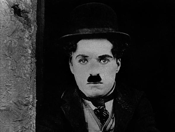 "Charlie Chaplin, performing in the role of ""Charlie"" in ""the Kid"" in Hollywood, California (AFP Photo/):"
