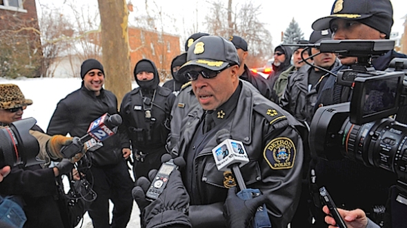 Detroit Police Chief James Craig speaks with the media during Operation Mistletoe, a raid targeting drug dealers on  Detroit's west side. Violent crime is down in Detroit, police have improved their response time to 911 calls and officers are solving a greater percentage of homicides, according to the Craig. (AP Photo/Detroit News, Steve Perez, FIle)