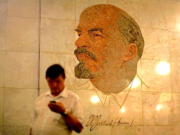 guys-on-phones-in-front-of-lenin-reuters