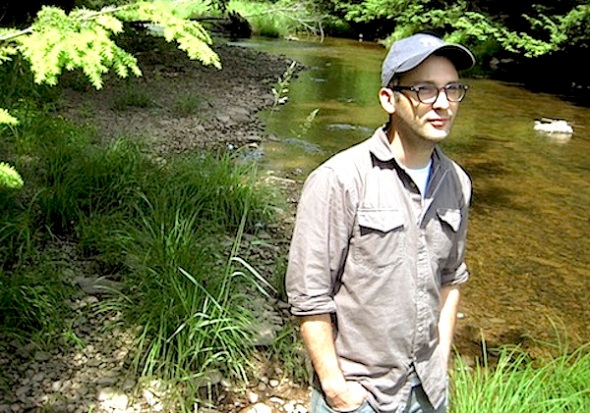 "In this June 15, 2010 photo, filmmaker Josh Fox poses along a stream running through his property in Milanville, Pa. Fox's new documentary, ""Gasland,"" takes on the natural gas drilling industry. (AP Photo/Michael Rubinkam)"