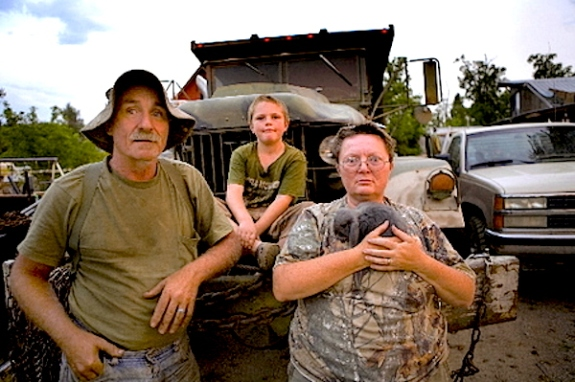 Ross William Hamilton/The Oregonian Dick and Gloria Shafer, pictured with their 9-year-old son, John, run an excavation business in Elgin. They are so frightened of drug violence, especially after a triple homicide at their town, that they say they sleep with handguns close at hand. Gloria Shafer keeps her 9 mm gun under her pillow.