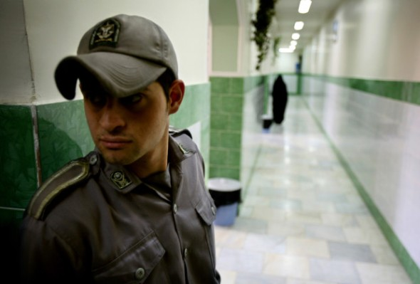 A prison guard stands along a corridor in Tehran's Evin prison June 13, 2006. Iranian police detained 70 people at a demonstration in favour of women's rights, the judiciary said on Tuesday, adding it was ready to review reports that the police had beaten some demonstrators. - RTXOQWJ