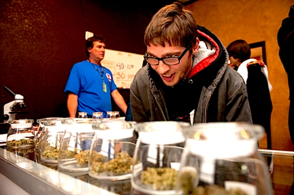 Tyler Williams peruses samples on the first day of recreational pot sales in Colorado. (Getty Images)