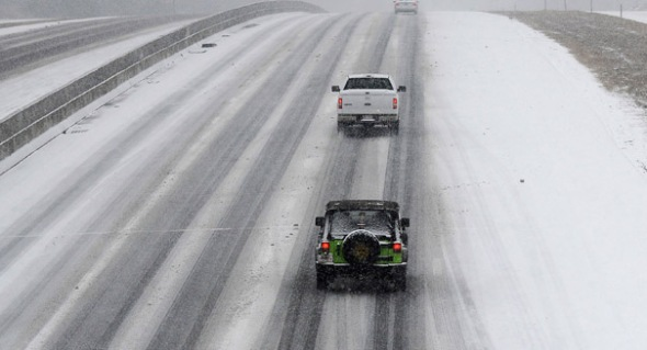By late afternoon some Raleigh motorists were abandoning their cars on the highway. | AP Photo