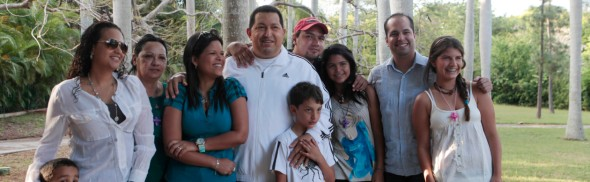 Venezuelan president Hugo Chavez (C) poses for a picture with his family while recovering in La Habana March 13, 2012. Chavez said he will return home from Cuba where he is recovering from cancer surgery next Sunday, to head up a re-election campaign. REUTERS/Handout/Miraflores Palace (CUBA -Tags: - Tags: POLITICS) FOR EDITORIAL USE ONLY. NOT FOR SALE FOR MARKETING OR ADVERTISING CAMPAIGNS. THIS IMAGE HAS BEEN SUPPLIED BY A THIRD PARTY. IT IS DISTRIBUTED, EXACTLY AS RECEIVED BY REUTERS, AS A SERVICE TO CLIENTS - RTR2ZAC6