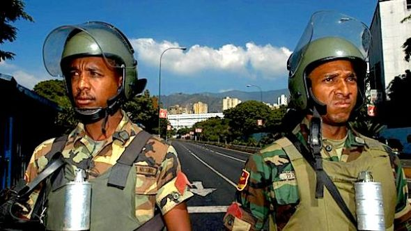 Members of the National Guard near the Miraflores Palace in Caracas, Venezuela. (GETTY IMAGES)