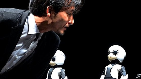 Japanese Tokyo University robot creator Tomotaka Takahashi chats with a humanoid robot