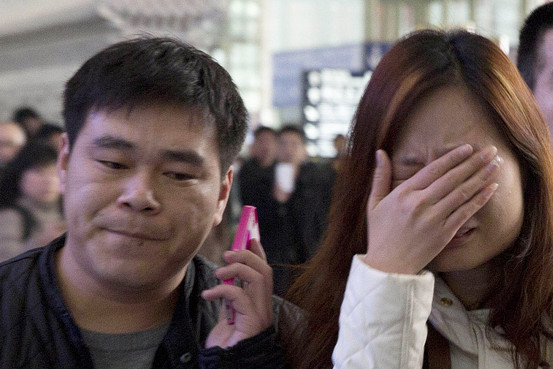 A relative of a passenger on Malaysia Airlines flight 370 cries out at a hotel in Beijing. Investigators were struggling to piece together what happened to the flight, which carried 239 people. Feng Li/Getty Images