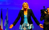 French far-right party leader Marine Le Pen arrives for a campaign meeting in Marseille, southern France, Sunday, March, 16, 2014. Municipal elections will take place on March 23 and 30 throughout France. (AP Photo/Claude Paris)