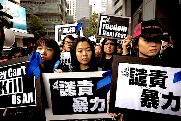 Ming Pao staff members marched in support of press freedom Sunday in Hong Kong, many carrying banners that read 'They Can't Kill Us All.' Reuters