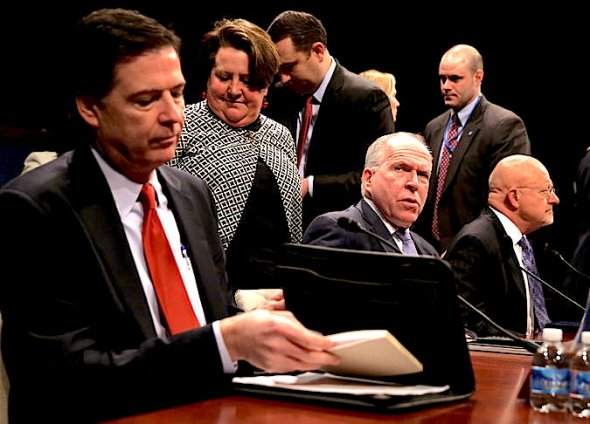 On Capitol Hill, Directors James Comey of the F.B.I., John O. Brennan of the C.I.A. and James R. Clapper Jr. of national intelligence. Credit Alex Wong/Getty Images