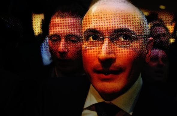 Former Russian oil tycoon and Kremlin critic Mikhail Khodorkovsky leaves the Wall Museum in Berlin on December 22, 2013 in Berlin after giving a press conference a few days after he was released after 10 years of jail. David Gannon/AFP