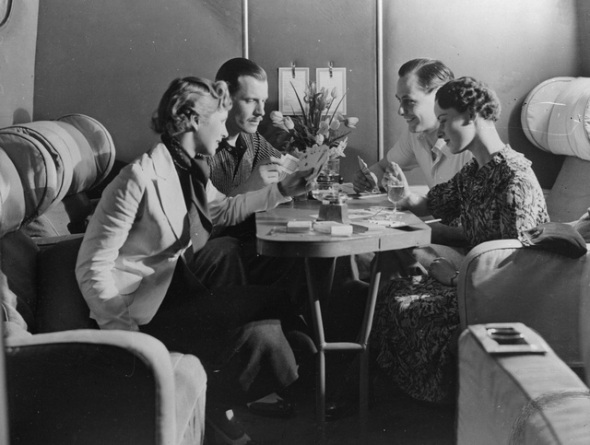 1936: Passengers enjoying a drink and a game of cards in the cabin of an Imperial Airways plane. (Photo by General Photographic Agency/Getty Images)