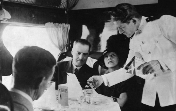 circa 1935: Waiter service aboard Imperial Airways 'Scylla' during its flight from London to Paris. (Photo by J. B. Collingham/Hulton Archive/Getty Images)