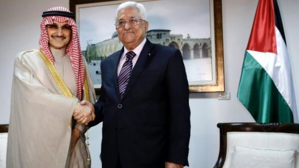 March 4, 2014 - Palestinian President Mahmoud Abbas, right, shakes hands with Saudi Prince Alwaleed bin Talal, during their meeting in the West Bank city of Ramallah. (AP)